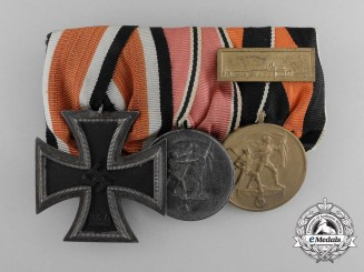 A Second War German Iron Cross & Campaign Medal Bar