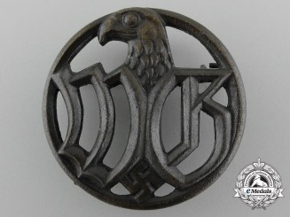 A Wehrmacht Entourage Badge by C.E Junker