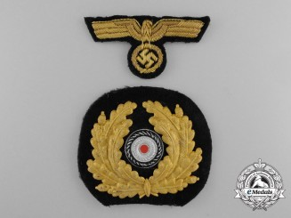 A Set of Kriegsmarine Navy Officer Peak Cap Badges