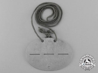 A Fine German Stab 4 Artillery Regiment 256 Identification Tag on Original String Necklace