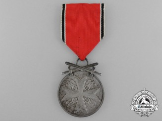 An Order of the German Eagle Medal; Silver Merit Medal with Swords