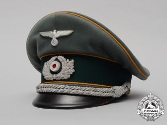 A Wehrmacht Heer (Army) Cavalry Officer Visor Cap by B-Hamkens, Hamburg