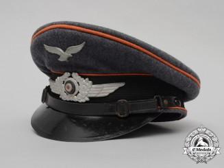 A Luftwaffe Ordnance/Signals NCO's Visor Cap/Schrimmütze