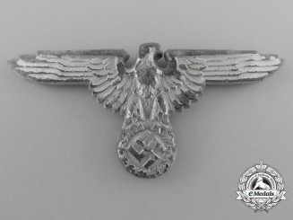 A Waffen-SS Officer's Visor Cap Eagle by Ferdinand Wagner