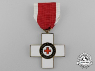 A 1st Model German Red Cross Honour Badge; 2nd Class