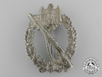 An Early Infantry Badge; Silver Grade by Juncker