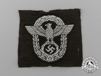 A Waffen-SS Police Field Cap Insignia