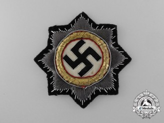 A Fine Quality German Cross in Gold for Panzer Units; Cloth Version by C.E. Juncker