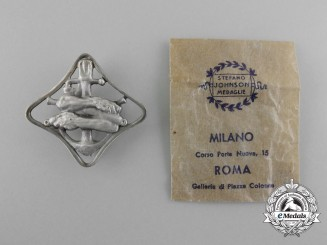 Italy, Kingdom. A Royal Navy Auxiliary Ships War Navigation Badge with Packet
