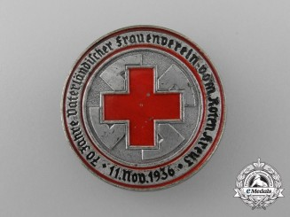 "A 1936 ""70 Years of the Red Cross Fatherland Women's Association"" Badge"