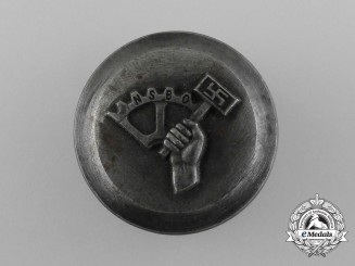 A Manufacturing Die for a NSBO Membership Stickpin or Badge