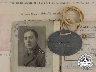An SS Soldbuch & ID Tag to the SS Volunteer Cavalry Regiment 1 & POW