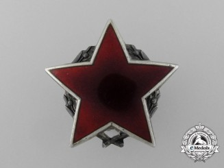 A Socialist Yugoslavian Order of the Partisan Star with Silver Wreath