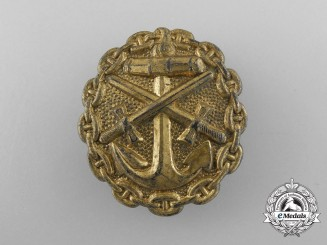 A German Imperial Naval Wound Badge; Gold Grade