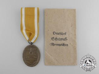 A West Wall Medal with Original Packet of Issue by Carl Poellath