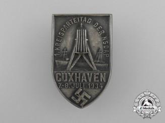 A 1934 NSDAP Cuxhaven 1st District Party Day Badge
