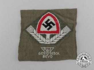 A Mint BeVo Reichsarbeitsdienst Cap Badge
