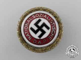 A NSDAP Golden Party Badge by Deschler & Sohn belonging to W. Fritzsche; Large Version