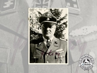 A Signed and Dated Photograph of SS-Hauptsturmführer Dieter Wisliceny