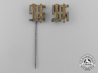 A Grouping of Two Reichsnährstand Membership Stick Pins and Badges