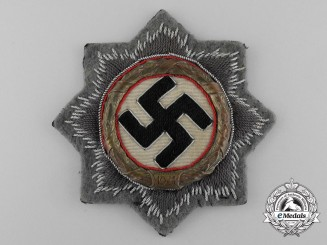 A Wehrmacht Heer (Army) Issue German Cross in Gold; Cloth Version by Hermann Schmuck & Cie