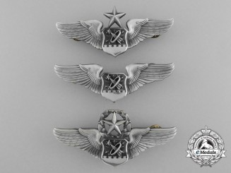 Three American Astronaut Badges