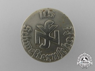 A National Socialist People's Welfare Sisterhood Membership Badge by F. Hoffstätter
