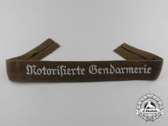 A Mint Motorized Rural Police (Motorisierte Gendarmerie) EM/NCO Cuff Title