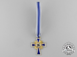 A Mint Golden Grade German Mother's Cross