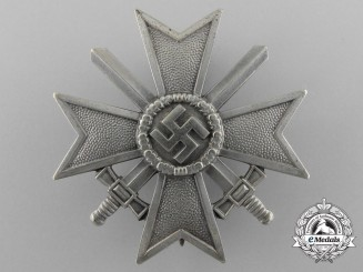 An Early War Merit Cross First Class with Swords by Kerbach & Osterhelt