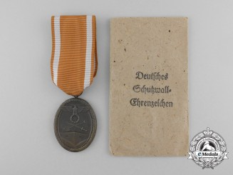 A Second War West Wall Medal with Packet of Issue by Carl Poellath of Schrobenhausen