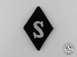 A Scarce Waffen-SS Quartermaster Sergeant Sleeve Diamond; removed from Salesman's Board