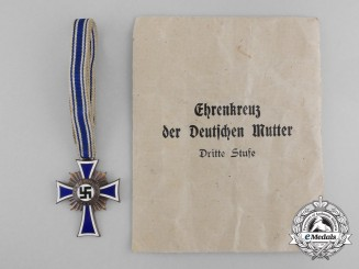 A Bronze Grade Mother's Cross with Original Packet of Issue by Wilhelm Schröder & Co.