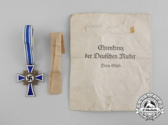 A Bronze Grade Mother's Cross in its Original Packet of Issue Named to Anna Alrecht by Heinrich Vogt