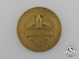 A Blut und Boden Reichsnährstand Pommern National Association of Farmers Badge