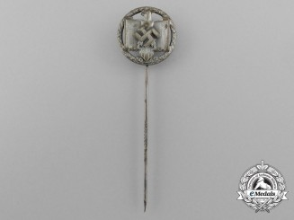A 1942 National Socialist League of the Reich for Physical Exercise Silver Grade Performance Badge
