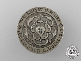 "A 1933 ""With Luther and A.H. for Faith and the Volk Wellbeing"" Badge"