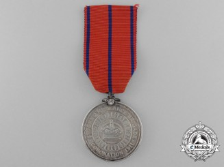 A Coronation (Police) Medal 1911 to Private J. Stratton St. John Ambulance Brigade