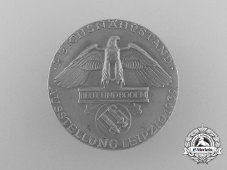 A Fine Quality 1939 Reichsnährstand/Blood and Soil Leipzig Exhibition Badge by Otto Fechler