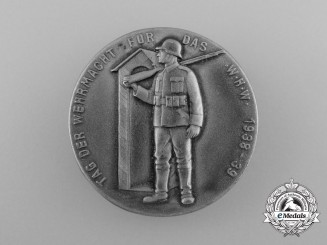 "A 1938/39 ""Day of the Wehrmacht of the Winter Relief for the German People"" Event Badge"