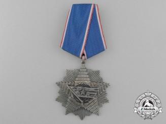 A Yugoslavian Order of the Yugoslav Flag with Silver Star