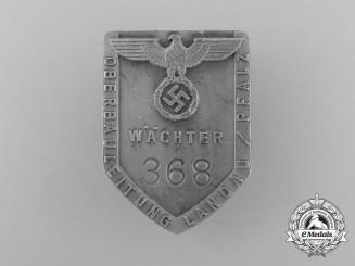 A Landau/Pfalz Construction Management Guard's Badge