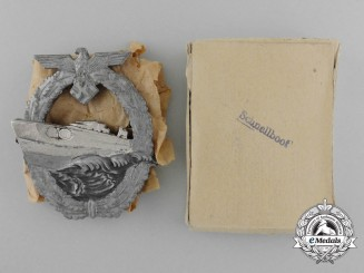 A Second Pattern Kriegsmarine E-Boat Badge by Schwerin in its Original Carton