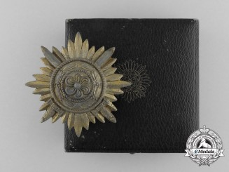 A First Class Ostvolk Bravery Decoration; Gold Grade with Swords & Case