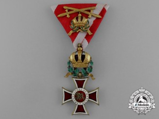 An Austrian Order of Leopold; Knight Commander with War Decoration and Crossed Gold Swords