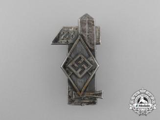 A Third Reich Period HJ Bann 223 Badge