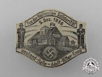 """Germany, Third Reich. A 1936 Neuland """"Day of National Solidarity"""" Badge"""