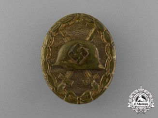 A Second War German Early Tombac Gold Grade Wound Badge