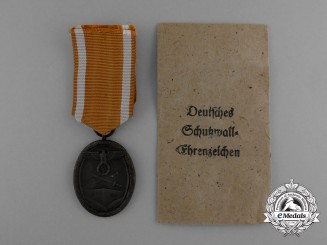 A West Wall Medal in its Original Packet of Issue by Karl Poellath of Schrobenhausen