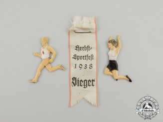 Germany. A 1938 HJ Fall Sporfest Winner Ribbon with Two HJ Figurines